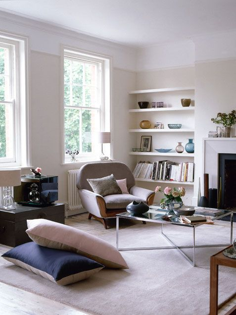 2 tone white walls, arm chair and built in shelves
