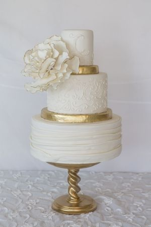 Beautiful white on white cake with just the right amount of gold trim.  ᘡηᘠ