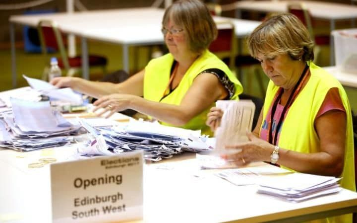 Election staff sort postal votes ahead of the General Election count at Meadowbank Sports Centre in Edinburgh.