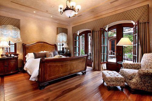 Master bedroom leather headboard and medium dark wood