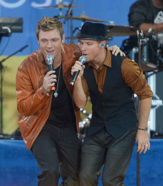 """Singer Nick Carter (L) and Brian Littrell of the Backstreet Boys perform on ABC's """"Good Morning America"""" at Rumsey Playfield, Central Park on August 31, 2012 in New York City."""