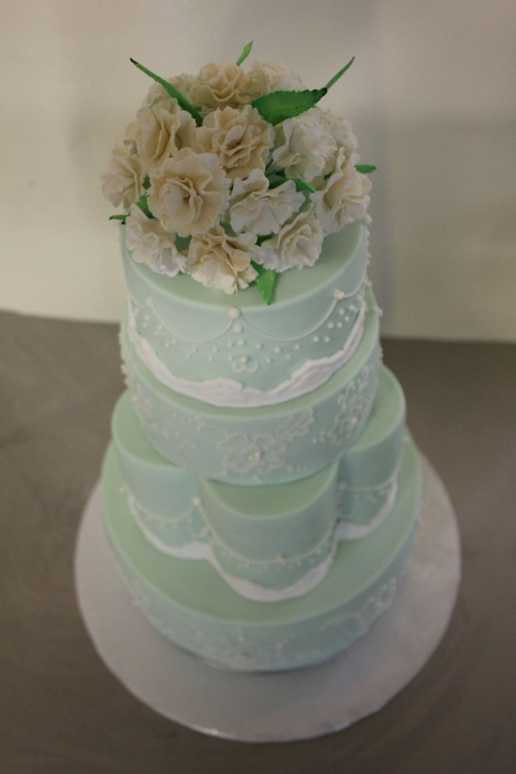 Pale Green Wedding Cake With Lace Brush Embroidery And Sugar Carnation Bouquet