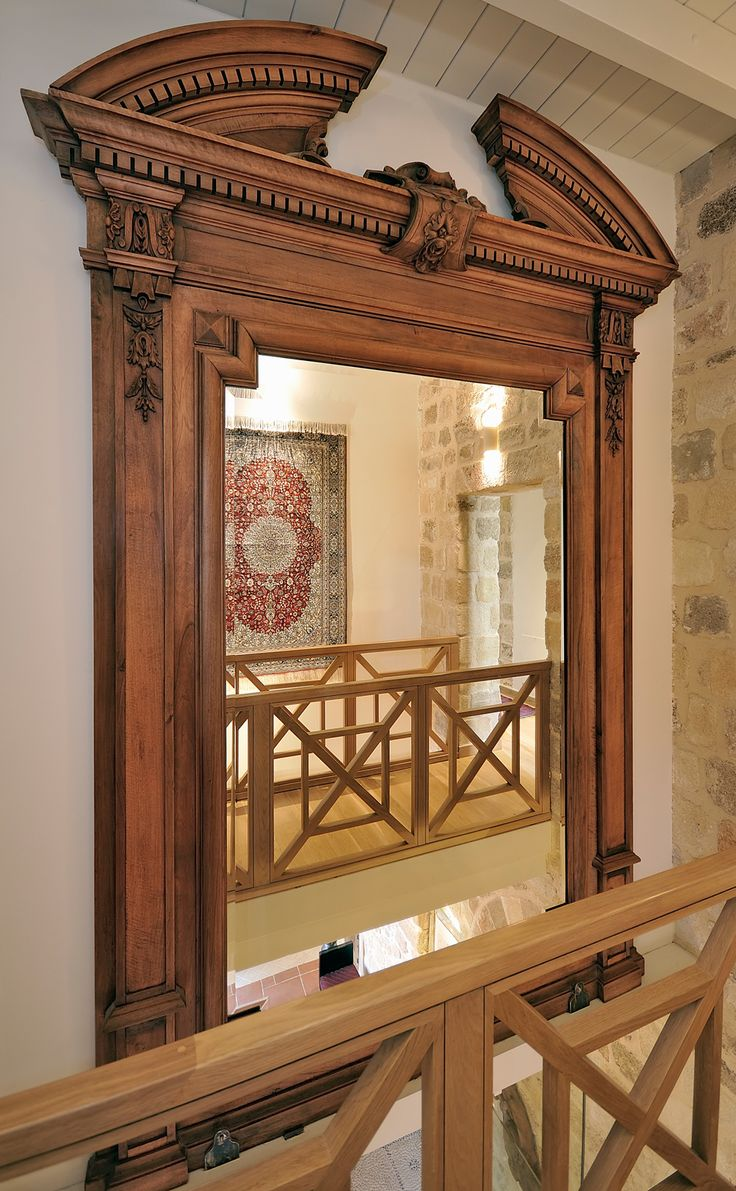 EXCLUSIVE SUITES BOUTIQUE HOTEL. MEDIEVAL TOWN, RHODES, GREECE. -  Mirror made of walnut tree wood. Ca 1910, for a house in Kifissia, Athens. Because of its height, we had to separate it from its base, which we turned into a coffee table in our salon. Seen from the bridge-way connecting the two parts of the first floor. Opposite was: silk carpet, southern China. - kokkiniporta.com