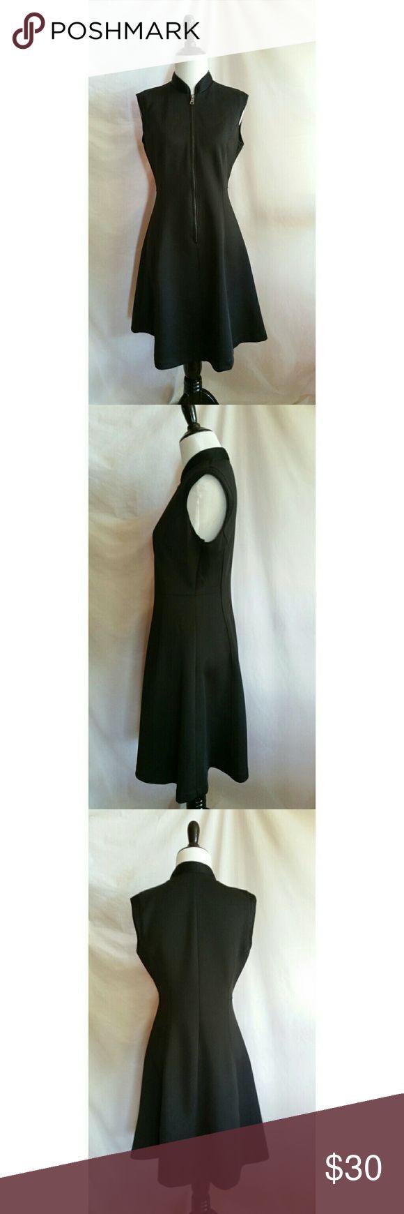Elie Tahari Size 6 Black Sleeveless Dress Elie Tahari for Design Nation.  Front zipper.  92% polyester, 8% spandex.  Machine washable Elie Tahari Dresses Midi
