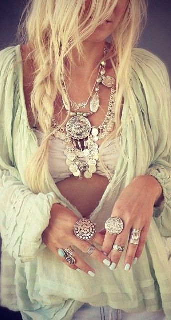 sheer whispy fabrics in light washed hues, messy beach blown hair  loads of silver adornments for the total boho chic!