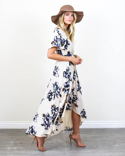 Spring vibes have arrived and our Blue Bonnet Maxi Dress is perfection! A cream hued wrap dress with dark blue and brown florals. This soft and vintage inspired dress features a fitted elastic waist a