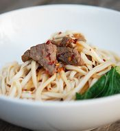 Satisfy your hunger with this easy beef noodle stir-fry recipe. Thinly sliced rump steak is marinated in soy sauce, mirin and sesame oil and then stir-fried with udon noodles and bok choy. Delicious.