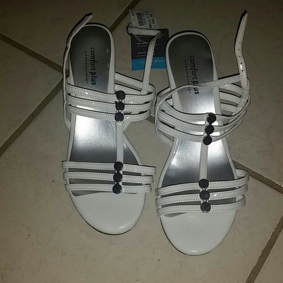 White wedge sandals White with silver wedge sandals, size 7.5, very comfortable  never worn Shoes Wedges