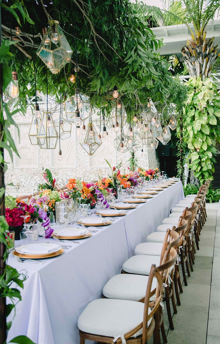 modern wedding receptions - photo by Imaj Gallery http://ruffledblog.com/vibrant-bali-wedding-with-a-hanging-botanical-installation