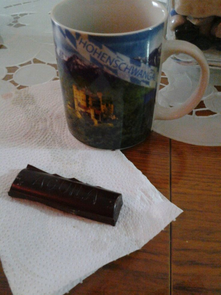 Nothing better than a rich cofee in my germany's cup and my chocolate