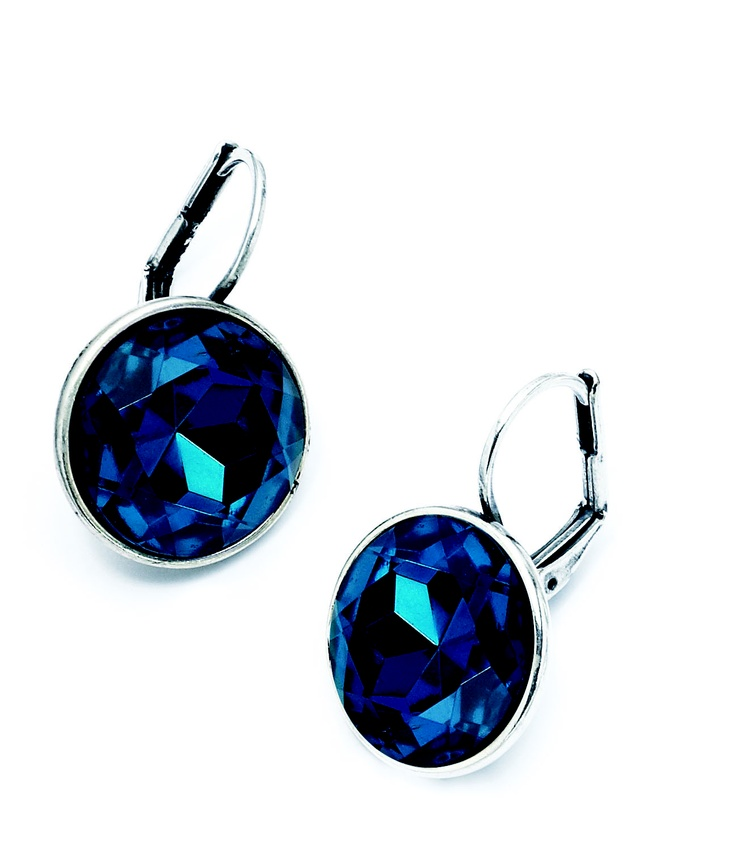 These dark blue crystal drop earrings are set in burnished silver and captures a true sense of sophistication.