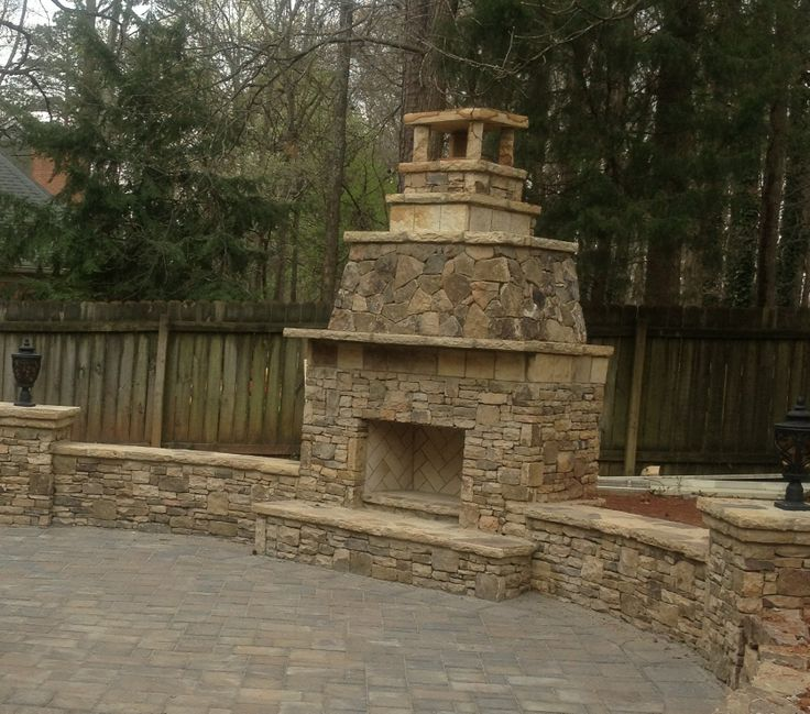 Stacked stone knee walls make great seating area by this ...