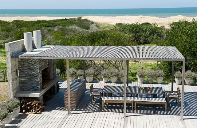 Viento del este, Uruguay. A solid roof could be used to funnel rainwater into a storage tank in addition to providing a sheltered cooking and eating area.