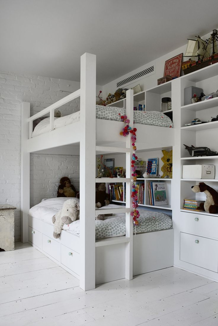 The kids, ages 10 and 11, share a room with built-in bunks each with its own shelves and surrounding drawers.