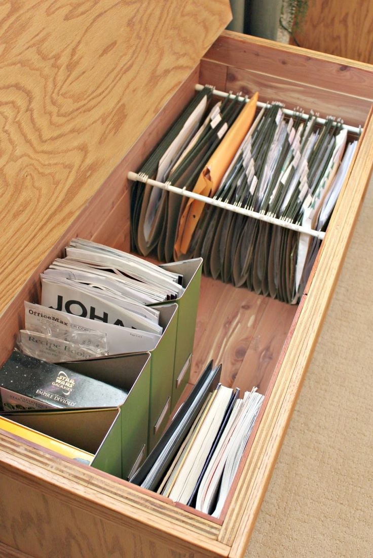 "Use Tension Rods To Create a Filing ""Drawer"""