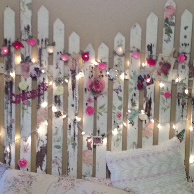 My moms homemade head board shabby chic fence stencils lights pictures and rhinestone pins she's insanely talented!