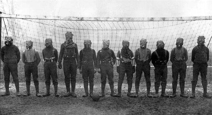 British soldiers play football while wearing gas masks, France, 1916 #History #War #FirstWorldWar #TheGreatWar #GasMasks