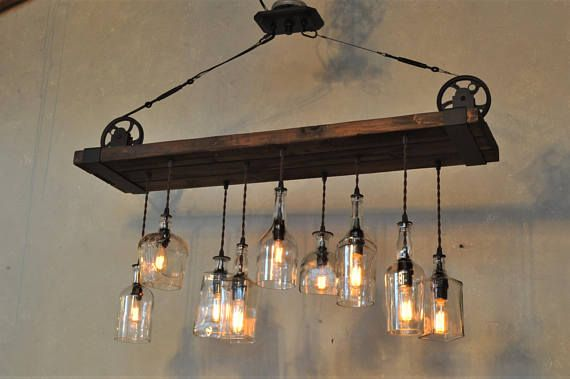Check out The Chesapeake rustic barn wood and steel chandelier suspended by metal pulleys, our newest design, originally commissioned by a customer on the east coast.