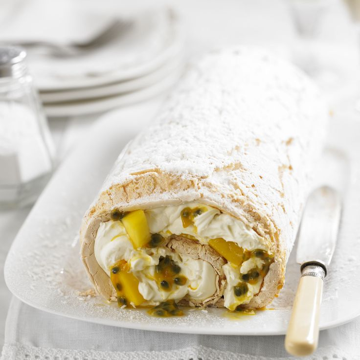 A tropical pavlova all rolled up! Passionfruit & mango meringue roulade recipe