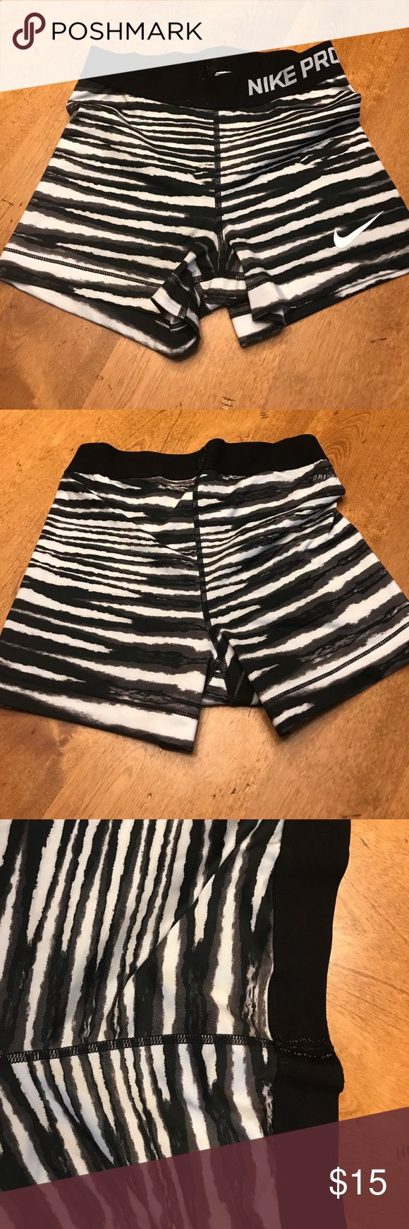Nike spandex shorts Perfect condition Nike spandex running shorts. Bought for one race for a team event, worn once. Zebra type print. Although they're white, not see through at all 👍🏻 do not rise up Nike Shorts