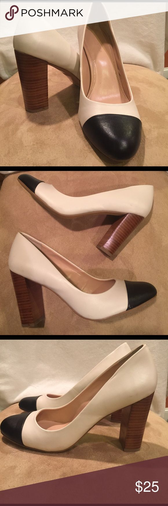 Banana Republic Pumps Cream pumps with Black Cape Toe. Gently used with minor scuff marks. Banana Republic Shoes Heels