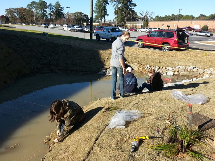 Edgecombe Community College student volunteers help with the #wetland construction on their campus #ptrf ptrf.org