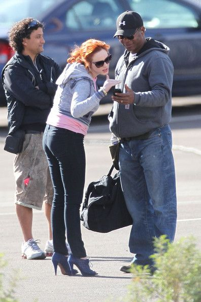 30c320620bdb Christina Hendricks wears a pair of high heels and dark skinny jeans while  on the set of her upcoming movie