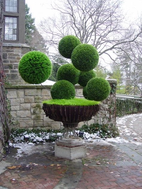Vintage French urn filled with plastic grass ball sculpture. I adore this.