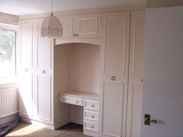 bedroom cupboards with dressing table