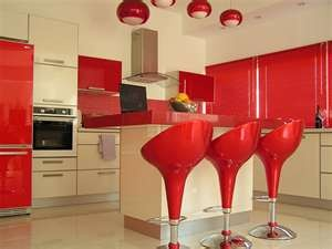 red-and-cream kitchen - like the idea of two different colour units.