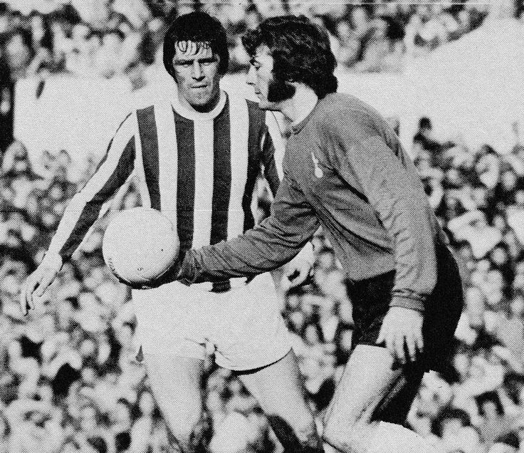 7th October 1972. Tottenham Hotspur goalkeeper Pat Jennings shadowed by Stoke City centre forward John Ritchie, at White Hart Lane.