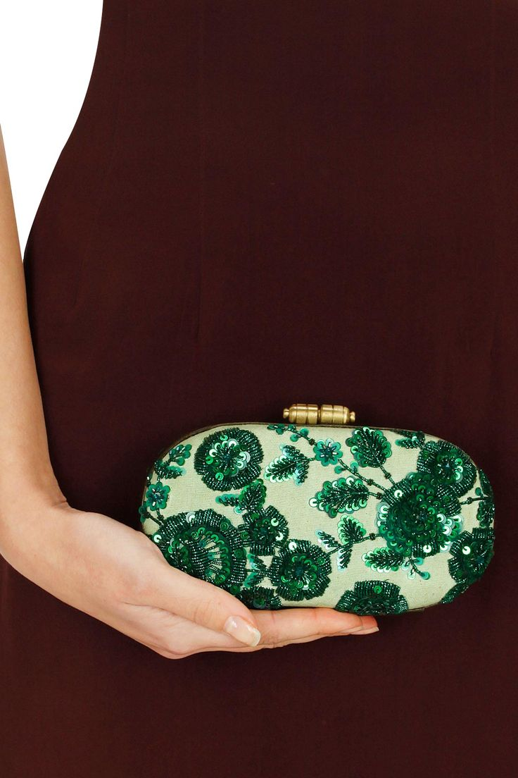 Mint green hand crusted leather minaudiere clutch available only at Pernia's Pop-Up Shop.