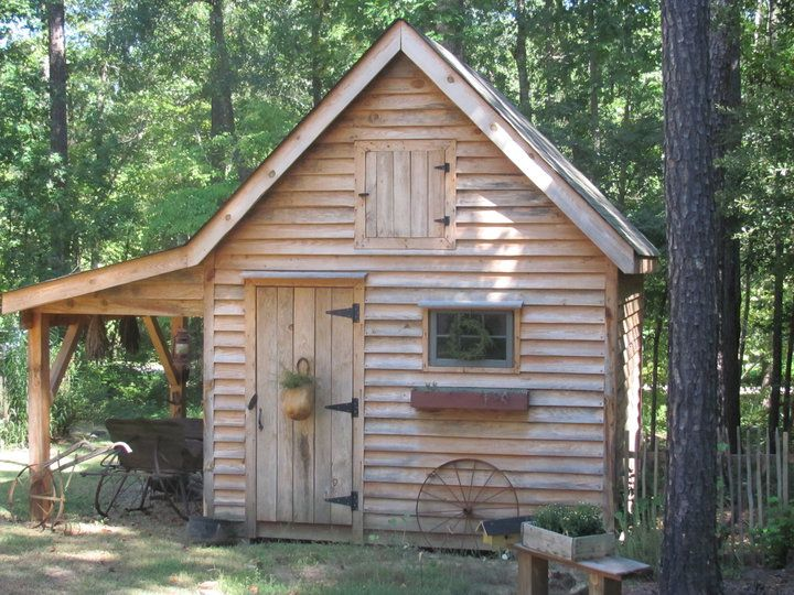 adorable shed with wood storage on the side