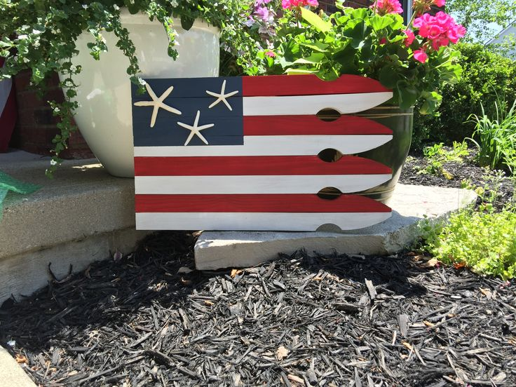 Patriotic starfish beach flag...one of my first creations!  This wood American flag is the perfect way to celebrate 4th of July, Labor Day, Memorial Day, or simply to add a patriotic touch to your home all year round. The addition of happy starfish gives this flag a beachy vibe which will fit in your home perfectly for a nautical or beach accent. Lightly distressed, sealed for protection and comes ready to hang.  $38.77