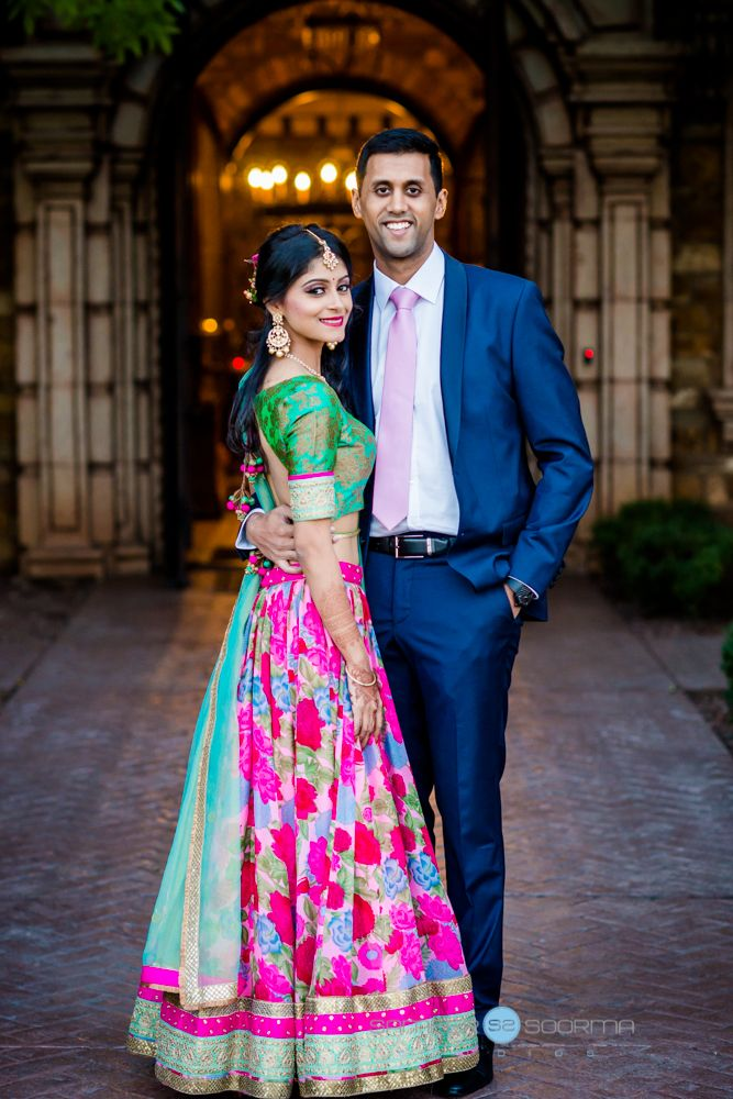Bride in traditional Indian sari of gold, pink and green with groom in blue suit | Sameer Soorma Photography | villasiena.cc
