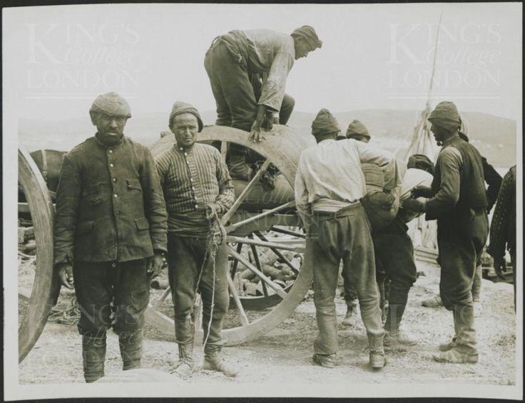 Turkish prisoner loading supplies onto a cart. Gallipoli.