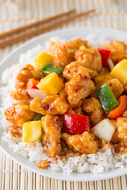 This Sweet and Sour Chicken recipe is better than your average Chinese takeout! Sweet and sour chicken is tossed with fresh vegetables and juicy pineapple for a tasty dinner recipe that's sure to please.