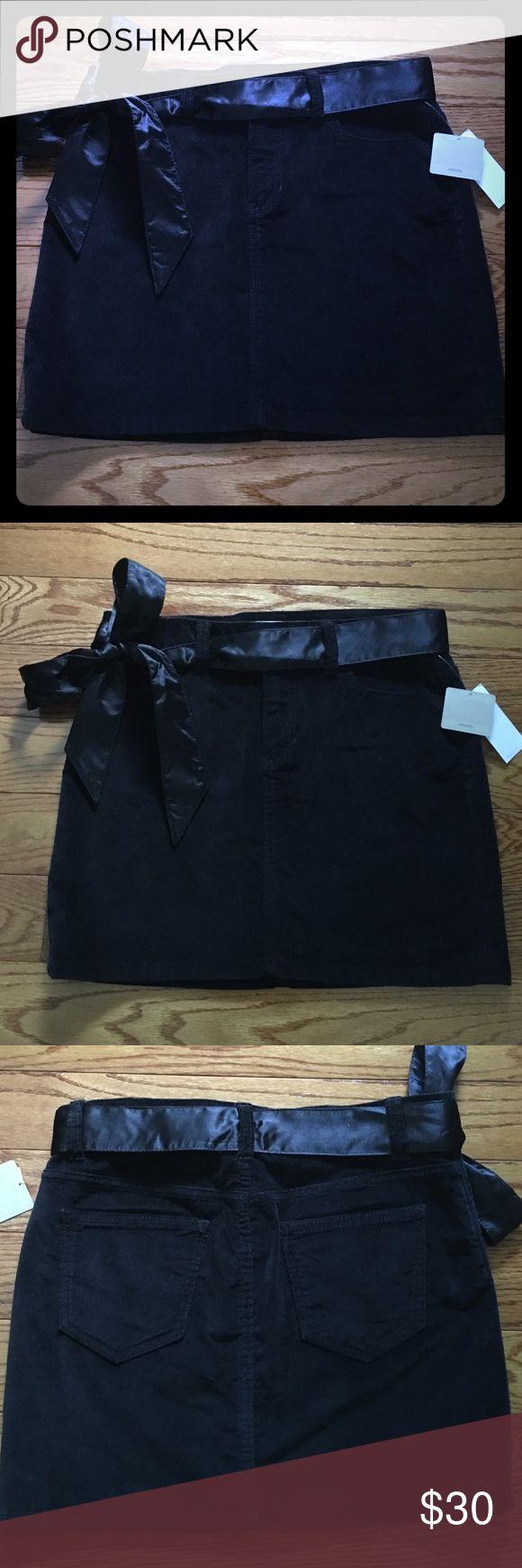"Black velvet stretch mini skirt w/ removable belt Super cute & sexy black velvet mini skirt with removeable silky belt. NWT! 98%cotton 2%lycra spandex. Size 4. Waist measures 32-33"" closed. Zip, hook, button closure. Front slant pockets. 2 back pockets. Just too short for my comfort level. I'm 5'5. Gap Skirts Mini"