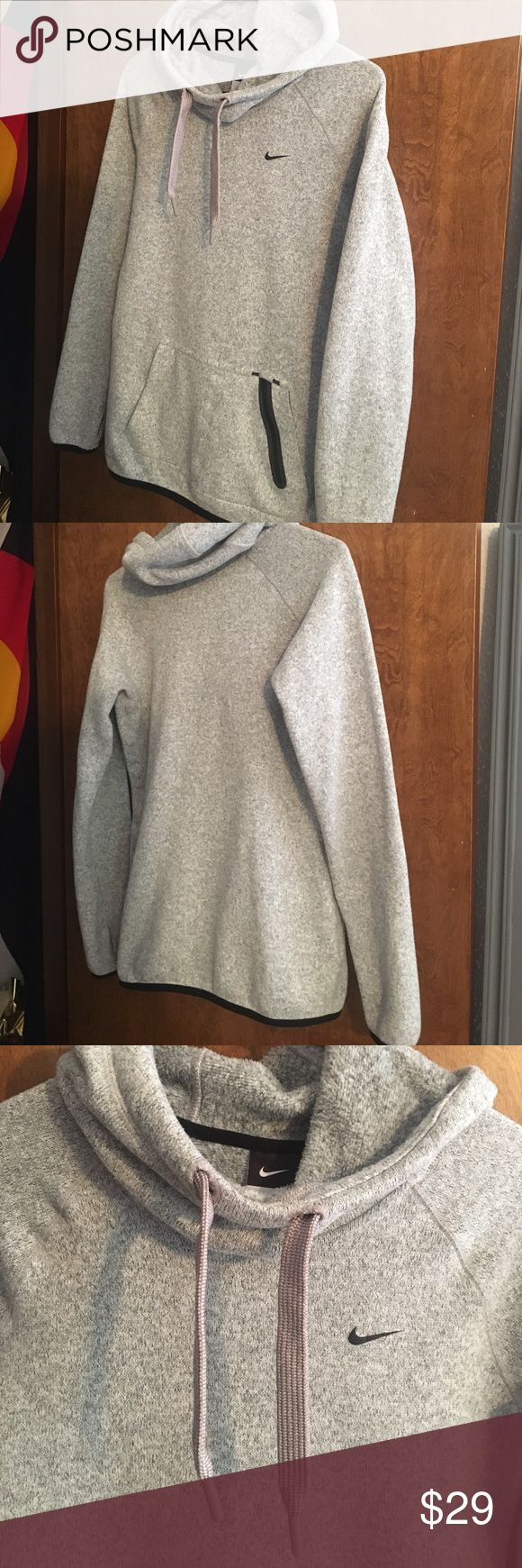 Nike Fleece Hoodie Super warm!!! Fleece hoodie. Great for a running in the winter, or a casual day bundled up. Great condition, some pealing from washer. So cute on. 💗 Nike Sweaters