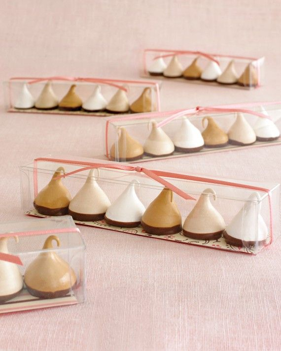 Package meringues in clear plastic boxes lined with patterned paper and tied with ribbon in a matching color for a sweet treat to send home with shower guests.