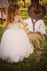 Little cowboy ringer bearer and his princess flower girl. Rustic Country Wedding.