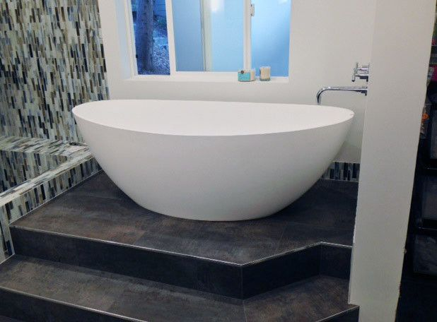 10 Modern Whirlpool Bathtubs Image for a Scandinavian Bathroom with a Orange Towel