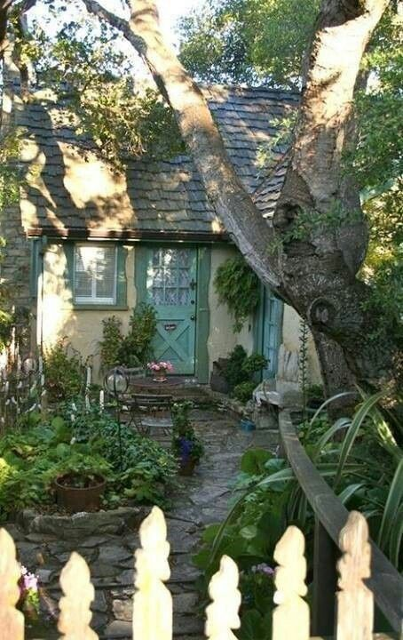 Cozy little cottage. Lovely. I like the flagstone path and stoop.