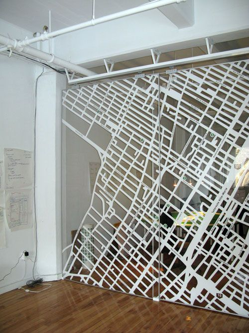 10 foot high acrylic divider map of the neighborhood on it - places you like restaurants and coffee shops etc
