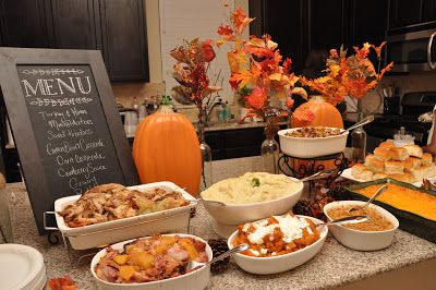 And seek to show hospitality. Thanksgiving dinner buffet set up on kitchen island. Write menu on chalkboard and use height to add dimension to the set up!