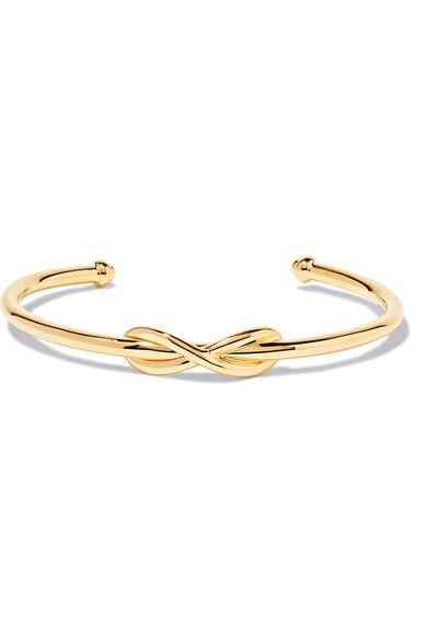 "Tiffany & Co.'s cuff is centered with an infinity symbol - the icon represents ""continuous connection, energy and vitality."" This sleek design has been meticulously crafted in Italy from gleaming 18-karat gold and easily slips on. It's perfect for stacking."