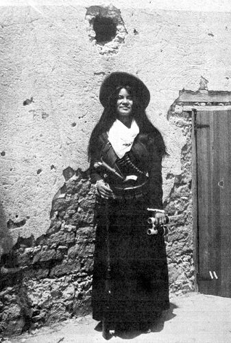 Yaqui Indian Soldadera de Sonora Mexico 1915 most likely part of Obregon's army, and it is likely that she was an officer, judging from her pearl handled revolver and her binoculars.