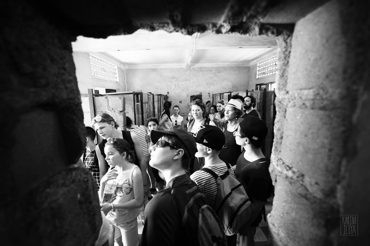 A student group visiting Tuol Sleng (S21) . Walking through the individual cell building