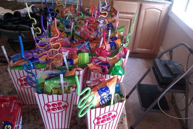 Cute party favors.... I could so much to fight this to be super duper cute. A bag of popcorn, a coke, a box of candy and gum.