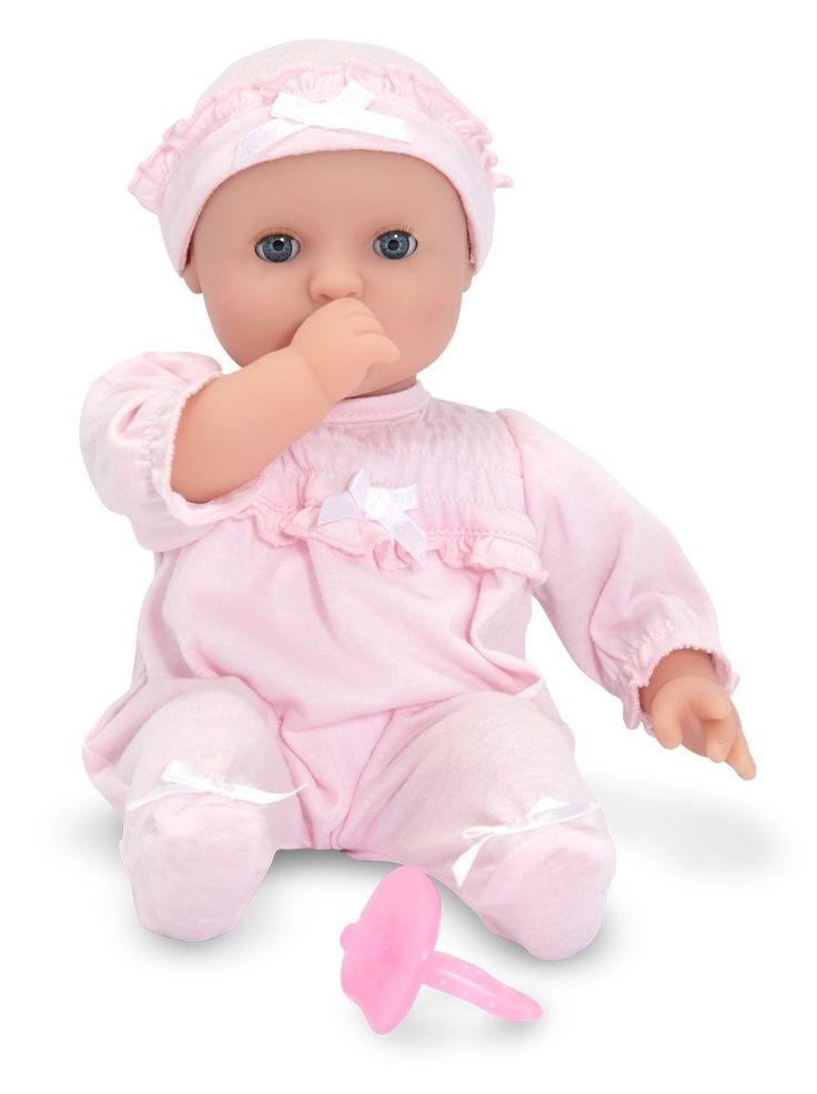 Melissa & Doug Jenna is een lieve babypop en kan op haar duimpje zuigen.